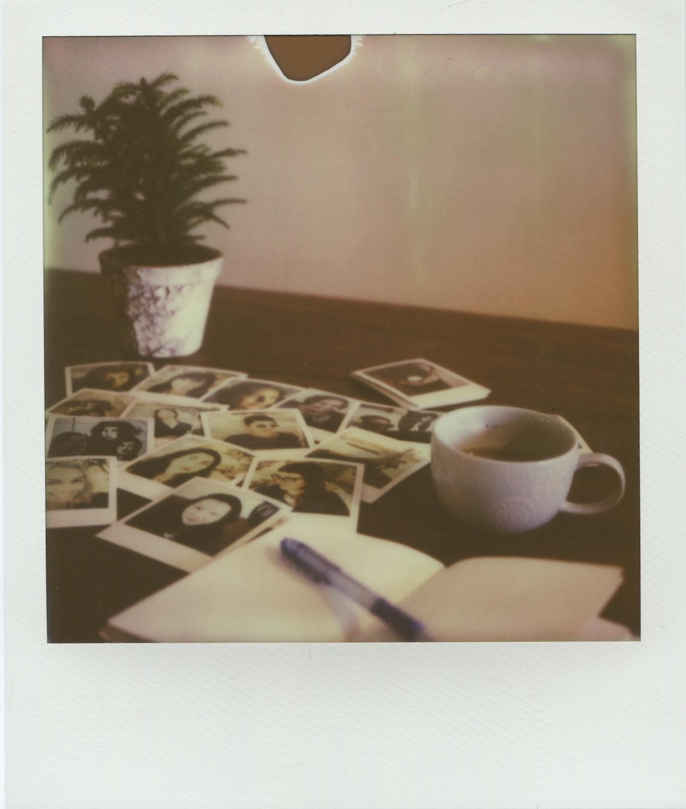 Polaroids portraits on a table